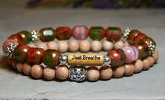 """A unique combination of czech glass and rosewood with beautiful colors. This set of 2 bracelets include a Natural Wood bead engraved with """"Just Breathe"""" surrounded by 8mm Czech Glass and is compliment"""