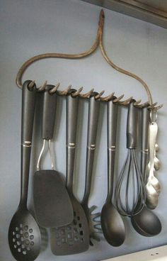 Recycle old rake into a line of hooks for kitchen or even in shed for small tools. Homesteading ideas