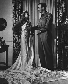 Actress and bride-to-be Elyse Knox tries on fabric from fiance's parachute, who was shot down over China. Parachute w bullet holes from Japanese Zeros was fashioned into wedding gown // 1944