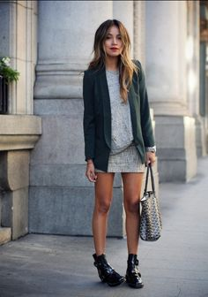 Shop this look on Lookastic: http://lookastic.com/women/looks/blazer-and-mini-skirt-and-tote-bag-and-ankle-boots-and-crew-neck-t-shirt-and-watch/2899 — Dark Green Blazer — Grey Mini Skirt — Black and White Geometric Leather Tote Bag — Black Cutout Leather Ankle Boots — Grey Crew-neck T-shirt — Silver Watch