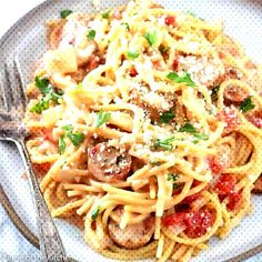 This Italian Sausage Pasta is made in one pot and is a family favorite. Sausage, tomatoes, and pasta coated in a cheesy sauce and ready in under 30 minutes! Sausage And Potato Bake, Sausage And Peppers Pasta, Italian Sausage Spaghetti, Italian Sausage Recipes, Italian Foods, Pasta Recipes, Chicken Recipes, Cooking Recipes, Healthy Recipes