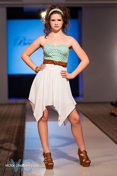 Joulia at NWA Fashion Week 2013! We have this dress available in mint and coral! Belt is available in color pictured, beige and black!!