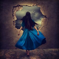 Back view of Girl wearing blue gown & hole to outside art