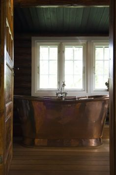 Copper - bath located in a timber house in Denmark and featured in the design magazine Bolig