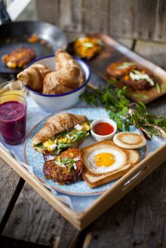Hole In The Bread Eggs…  Scrambled Eggs with Goats Cheese and Rocket…  Frozen Fruit Smoothie…  Sweet Potato Breakfast Fries…
