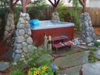 This   Yard Crashers   hot tub is decked out with a custom cover featuring a stone veneer, flagstone path and a delightful group of summer plantings, including  black-eyed Susans  and  blanket flowers .