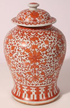 """Fine Chinese Porcelain Covered Jar baluster form with painted scrolling floral and mums likely from the Kangxi period in iron red glaze, 10""""diameter x 16""""high."""