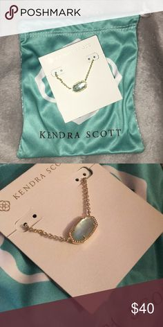 NEW KENDRA SCOTT NECKLACE Never been worn. The chain is gold and the color stone is a light blue Kendra Scott Jewelry Necklaces