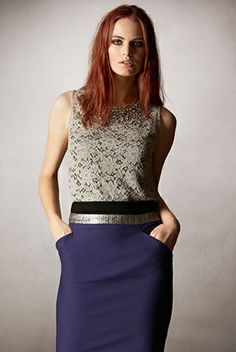The Fenn trim skirt is cut from ottoman cotton, giving the skirt a structured look and feel. The pencil skirt features asymmetric front pockets and a metallic coated tweed waistband. Wear with the Louisa Lace Top for a desk to dinner look. Georgie is 5'10/178cm and wearing a size UK8.  http://www.caribbeanfashionspot.com/pages/High_Fashion_Collection