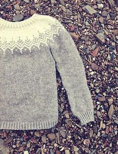 "When I posted this sweater on my blog I named the headline "" The softest sweater ever"" and that softness is why this is still one of my absolute favorite designs. I combined two yarns to get that warm woollen sweater feeling and added some extra fluff with a thinner brushed alpaca yarn. The pattern is very simple with a feather motif around the yoke. The fit is quite loose which will make this the coziest knit your closet will ever see. I chose to use a lighter color closer to the face to…"