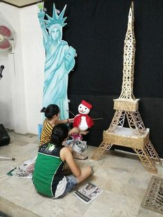 Christmas around the world decorations. Eiffel tower made up of popsicle sticks