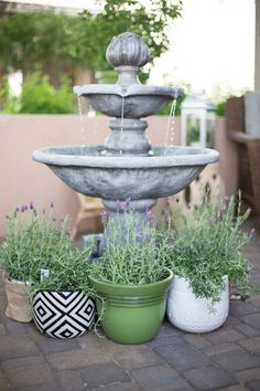 The fountain offers a focal point for this patio. The trickling water adds a peaceful aural appeal. The rosemary and lavender plants provide sweet smells. See more of this sensual courtyard designed by  Destiny Alfonso of Just Destiny Mag  on The Home Depot Blog. || @justdestinymag