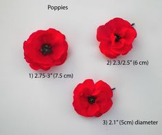6cm across. Pair of red  felt poppy hair pins