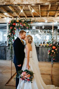 Industrial Mill Wedding with Spectacular Florals & Feathers