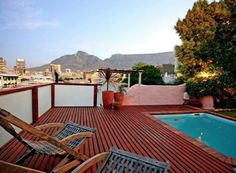 Cape Lights in Cape Town (Sleeps . This trendy self-catering apartment has spectacular views of the V & A Waterfront, City and Table Mountain from its own private wooden deck and balcony. Cape Town Accommodation, V&a Waterfront, Table Mountain, Wooden Decks, The V&a, 2 Bedroom Apartment, City Break, Lights, Catering