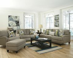 Even though I lean toward soft neutrals in my furniture, I do like splashes of bright color. A great trend is pattern mixes. Same colors/different patterns—like striped and floral pillows sharing the same space. | Hariston Shitake | Ashley Furniture HomeStore