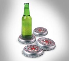 Giant Bottle Cap Coasters - Gadgets Magazine - The giant bottle cap coasters are made from plastic, have rubber feet on the bottom to prevent the caps from sliding