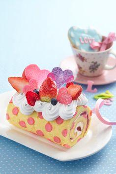 Pink polka dotted sponge cake roll