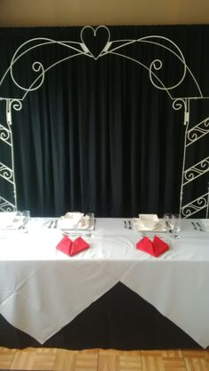 sweetheart table accented with heart napkins and the sweetheart arch Drapery, Valance Curtains, Sweetheart Table, Spice Things Up, Wedding Accessories, Arch, Napkins, Weddings, Home Decor