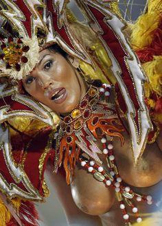 A reveler of the Mocidade Independiente samba school participates in the second night of the annual Carnival parade in Rio de Janeiro's Sambadrome, 2011.