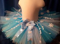 Handmade Frozen inspired tutu for Queen Elsa. This beautiful tutu has snowflakes all over it! Each snowflake sparkles and shines as your little