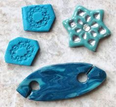 Polymer Shuttle       Was playing with some polymer clay.  These are the results of my scraps.  The two pieces in the upper, left are press molds for polymer clay.