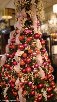 hese ideas are worth trying this time on the Christmas. Your tree would garner more praises than the readymade ones. Share these amazing and quick Christmas tree ideas with others to make your Christmas tree best in the town. Pink Christmas Tree, Beautiful Christmas Trees, Noel Christmas, Victorian Christmas, All Things Christmas, Christmas Tree Decorations, Christmas Crafts, Pink Decorations, Peacock Christmas