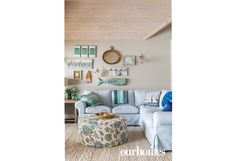A sectional blue sofa with pastel pillows and throws helps create a coastal theme in this corner of the living room. http://www.ourhomes.ca/articles/build/article/lake-peninsula-prize
