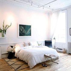 Low platform beds & wooden floors make for the dream bedroom //The Line via ELLE Decoration //