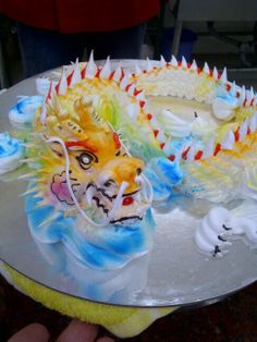 Piped dragon sculpture made entirely from topping, by a vietnamese msdtet pastry chef, amazing!