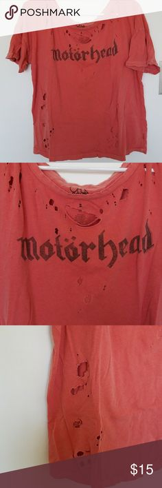 Motorhead t-shirt from Brandy Melville Torn up Motorhead t-shirt. Big open neck so it'll fall off one shoulder if you want that look. Burnt orange color. Brandy Melville Tops Tees - Short Sleeve