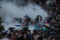 Hong Kong Pro-Democracy Protesters Clash With Police In Surreal Scenes