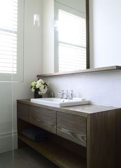 Simple timber vanity with shelf, mirror sitting on shelf. Our shelf wont be as wide as the vanity, and will be centred (Templeton Architecture)