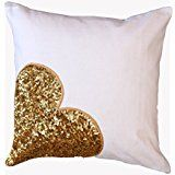 "Add a romantic touch to your decor with the ""Golden Heart"" cushion cover. It is hand crafted with rich Indian Zari art. This cushion cover is ideal for both the bedroom and living room. In fact, it makes a lovely gift for friends as well."