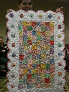 quilt with squares in center, dotted scalloped border.