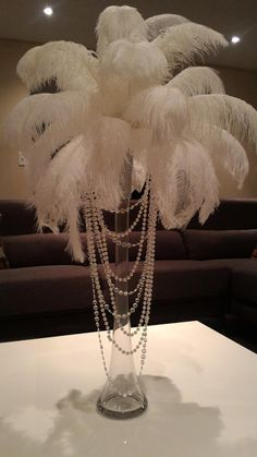 Ostrich Feather Centerpiece with Acrylic and Pearl Garlands for a Vintage Roaring Look! - Informations About Ostrich Feather Centerpiece with Acrylic and Pearl Garlands for a Vintage Roarin - Roaring 20s Party, Gatsby Themed Party, Roaring 20s Wedding, Speakeasy Party, Roaring Twenties, Masquerade Party Decorations, Great Gatsby Party Decorations, Masquerade Theme, 1920s Decorations