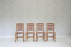 A set of four oak framed and rush seated dining chairs/ kitchen chairs