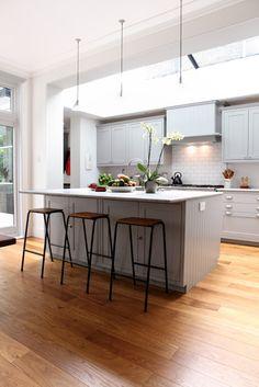 Bright kitchen, skylight, light grey cabinets, wood floors
