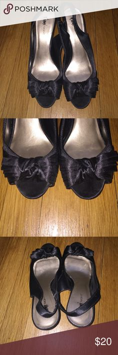 Black back strap heels Black back strap silk heels are great to dress up or down! Little bow design in front. Lightly worn size 8.5 Shoes Heels