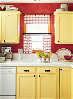 red walls, yellow cabinets, white counter, black hardware