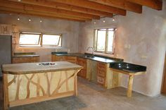 Straw Bale Home Design- simple kitchen- I think James needs more cabinets