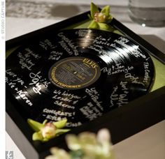 The Details    In lieu of a standard guest book, guests used a metallic pen to sign a record of the couple's first dance song.