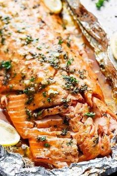 Honey Garlic Butter Salmon In Foil (Cafe Delites) - - Honey Garlic Butter Salmon In Foil in under 20 minutes, then broiled (or grilled) for that extra golden, crispy and caramelised finish! So simple and only 4 main ingredients, with minimal clean up! Salmon Dishes, Fish Dishes, Seafood Dishes, Seafood Recipes, Vegetarian Recipes, Dinner Recipes, Cooking Recipes, Healthy Recipes, Side Dish For Salmon