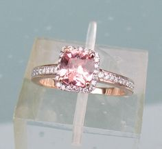 Peach Pink Sapphire Engagement Ring in 14k Rose Gold Diamond Halo May Birthstone Gemstone Ring. $620.00, via Etsy.