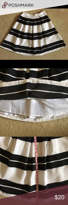 """Express black & white striped A line skirt A black and white striped A-line skirt from Express. Worn once. Has some wrinkles from being in the closet but still looks brand new. There are pockets on the side and a side zip. Measurements as above in the photos. I am 5'10"""" and this skirt comes to my knees when I wear this on my waist. I am open to offers. Please use the offer button. Express Skirts A-Line or Full"""