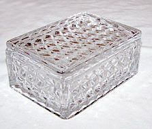 This is an Elegant Glass cigarette box in the American pattern made by Fostoria. It measures 4.75 by 3.5 and 2.25 inches high. This piece is in nice condition with no chips or cracks.