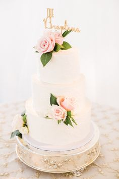 beautiful cake with rose accents from New Hill North Carolina wedding http://trendybride.net/the-bradford-new-hill-north-carolina-wedding/ {trendy bride}