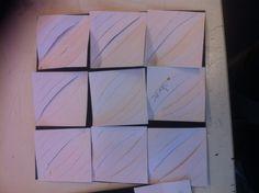Een structuur van negen vierkantjes met ronde lijnen.