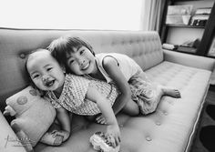 Black and white lifestyle portrait of sisters.  The baby photo on this post makes me happeeeeee.  | Trish Reda Photography