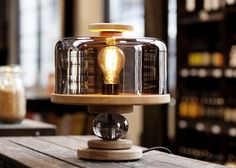 Bake me a cake is a charming and playful table lamp made of oak wood and smoked, tinted glass. Simply lift up the glass to change the bulb. The lamp offers a dim light. Design Light, Lighting Design, Luxury Lighting, Light Table, Lamp Light, Ampoule Design, Diy Luminaire, Warm Industrial, Industrial Lamps